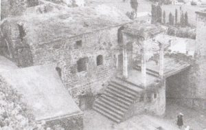 Figure 2: Courtyard of the convent from the southeast (1967). Entrance to the cave church is bottom left. Entrance to the convent is under the belfry (Bryer 1968, p. 100)